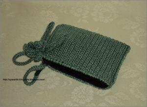 Вязаный кошелёк зелёного цвета